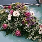 1.12 Gesteck mit Blumen der Saison, € 74,-