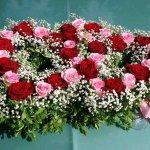 6.5 - 2 verflochtene Herzen mit Rosen und Frischgrün, € 139,-